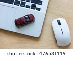 car model on notebook and mouse ... | Shutterstock . vector #476531119