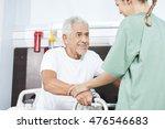 nurse helping smiling senior... | Shutterstock . vector #476546683