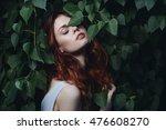 woman in green leaves enjoying... | Shutterstock . vector #476608270