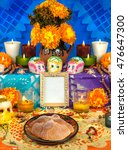 Small photo of Day of the dead altar with sugar skulls and candles, blue background