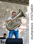Small photo of Moscow, Russia - July 31, 2016: trumpet from Cover band Brevis Brass Band performance on a city street. It is unique Moscow cover team with prodigious energy, consisting of a cheerful young people.: