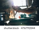 skillfully melting metal for a... | Shutterstock . vector #476792044