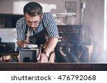 honing his jewelry designs | Shutterstock . vector #476792068
