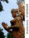 Small photo of CALAUAN, LAGUNA, PHILIPPINES - AUGUST 28, 2016: Huge concrete mermaid carved statue stands aloof under blue sky in an Asian aquatic jungle theme park