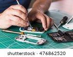 man repairing broken smartphone ... | Shutterstock . vector #476862520