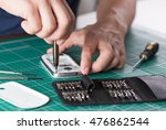 man repairing broken smartphone ... | Shutterstock . vector #476862544