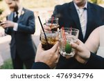 guests clang glasses with iced... | Shutterstock . vector #476934796