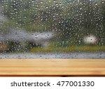 Wood Table Top On Rain Drops O...