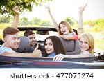 happy friends in car | Shutterstock . vector #477075274