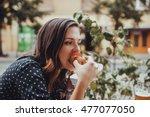 Young Woman Eating A Hotdog