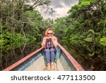 happy tourist woman in a canoe... | Shutterstock . vector #477113500