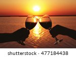 couple hands with wine glasses...   Shutterstock . vector #477184438