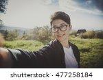 guy makes selfie photo on the...   Shutterstock . vector #477258184