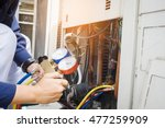 technician is checking air... | Shutterstock . vector #477259909