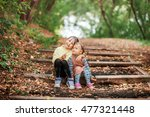 the small children sitting on... | Shutterstock . vector #477321448
