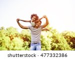 child flying on father... | Shutterstock . vector #477332386