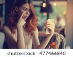 woman with a phone in front of... | Shutterstock . vector #477466840