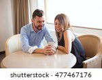 cute couple looking at some... | Shutterstock . vector #477467176