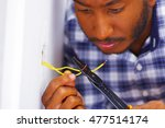 man wearing white and blue... | Shutterstock . vector #477514174