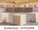 Small photo of ACCOST word written on building blocks concept