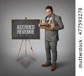 Small photo of Accrued Revenue text on blackboard with businessman