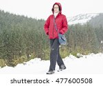 young woman walking in snowy... | Shutterstock . vector #477600508