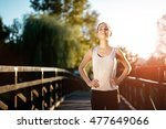 sporty woman living a healthy...   Shutterstock . vector #477649066