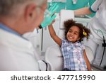 lovely kid in dental chair... | Shutterstock . vector #477715990