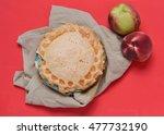 A White Peach Pie On Tan Flowe...