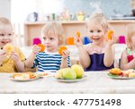funny kids eating fruits in... | Shutterstock . vector #477751498