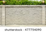 fence brick wall and green leaf | Shutterstock . vector #477754090