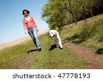 Stock photo photo of girl and labrador walking on the road 47778193