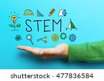stem concept with hand on blue... | Shutterstock . vector #477836584