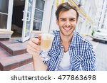 happy guy enjoying hot beverage