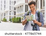 carefree young man searching... | Shutterstock . vector #477865744