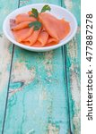 smoked salmon pieces in white... | Shutterstock . vector #477887278