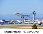 Small photo of LOS ANGELES/CALIFORNIA - AUG. 12, 2016: Aerologic Airlines Boeing 777-FZN commercial cargo aircraft is airborne as it departs Los Angeles International Airport, Los Angeles, California USA