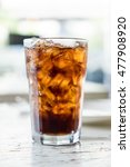 iced cola glass on the table | Shutterstock . vector #477908920