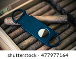 cigar cutter and cigars in... | Shutterstock . vector #477977164