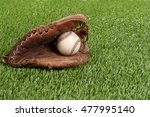 baseball glove and hard ball | Shutterstock . vector #477995140