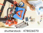 Small photo of Smart engineer constructing additive manufacturing equipment