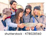 group of friends looking map in ... | Shutterstock . vector #478028560
