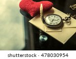 Small photo of Vintage antique watches and airmail letter and red heart on Glass table for valentine day