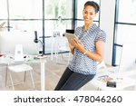 Small photo of Portrait of smiling afro-american office worker in offfice