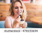 nice young woman eating desert | Shutterstock . vector #478153654