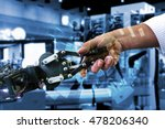 Cyber communication and robotic concepts. Industrial 4.0 Cyber Physical Systems concept. Robot and Engineerer human holding hand with handshake and graphic for background