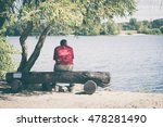 Old Man Sitting On A Bench By...