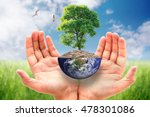hands hugging a big tree globe... | Shutterstock . vector #478301086