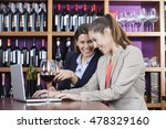 friends enjoying red wine while ... | Shutterstock . vector #478329160