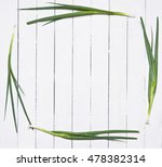fresh chives on rustic wooden...
